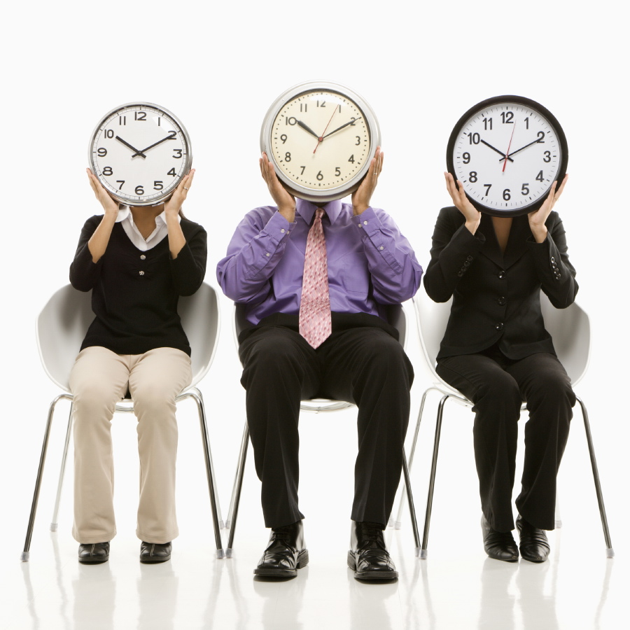 Picture of workers with clocks instead of heads